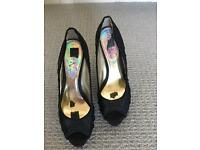 Black satin slightly platformed next shoes size 5