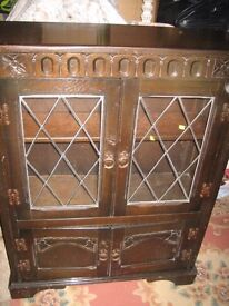Dark wood cabinet/bookcase/storage etc. Leaded glass doors.Ideal upcycle project or keep as it is.