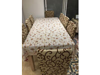 ***LOVELY DINING TABLE - SEATS 8 COMES WITH FREE TABLE CLOTH AND CHAIR COVERS***