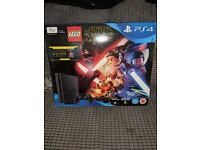 Brand New still in box 1TB PS4 with LEGO STAR WARS game and Blu Ray