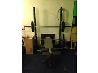 Smith Machine, EZ Bar, weight plates, 2 dumbbells and sit up bench