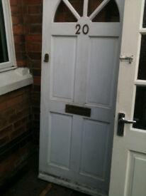 Exteior hardwood door with clear half circle glass