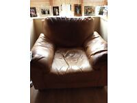 Leather armchair and foot rest for sale