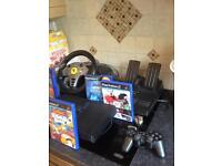 Ps2 with 7 games and one controller and full working car set with pedals