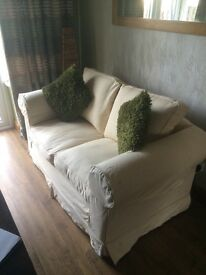 Lovely 2 Seater Cream Sofa. Excellent Condition. Can Deliver.