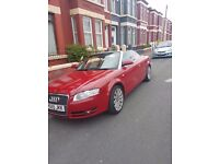 Red audi a4 convertible