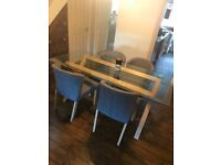 Dining table and chairs glass top