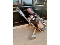 Golf clubs, bag, trolley, gloves and balls