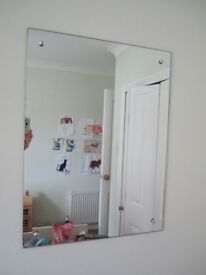 Bathroom or bedroom rectangular mirror in good condition measures Height 24 inches by Wid 18 inches