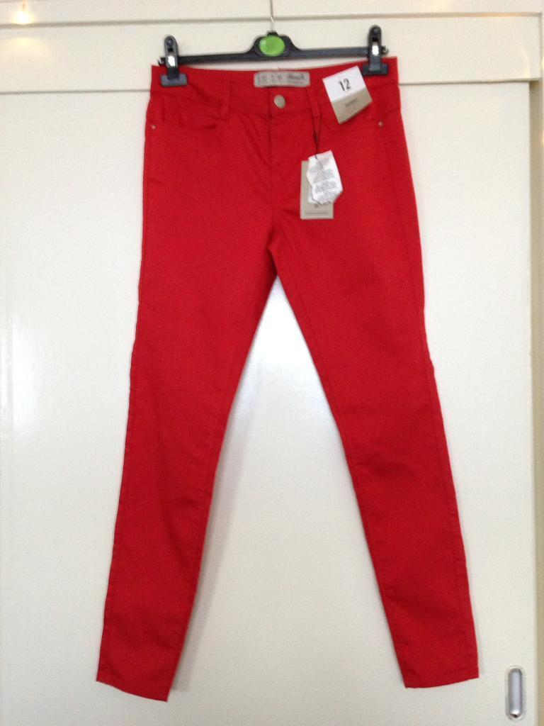 New women's size 12 red stretch jeans