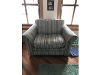 Gorgeous Teal cuddle chair from Harvey's