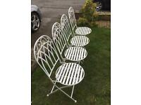 Wrought iron garden bistro chairs