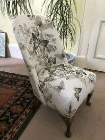 tunning small chair completely reupholstered with pink and grey butterfly fabric