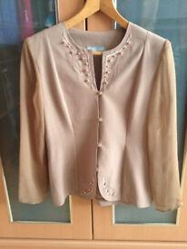 An elegant, evening women's shirt/jacket