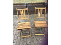 Two small folding wooden chairs. Fold flat for storage