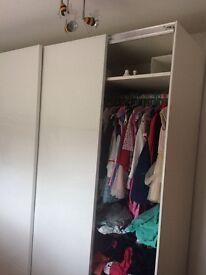 High gloss white pax wardrobe