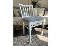 White shabby wooden chair and grey fluffy seat covers