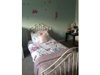 Metal bed frame with love hearts