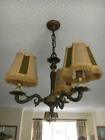 Pair of brass ceiling lights with shades