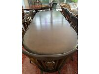Black Oak dinning table and 8 chairs.