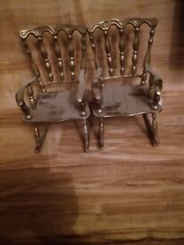 Brass ornamental rocking chairs