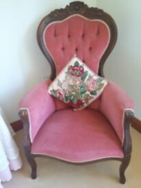 Two pink velvet and wood chairs