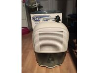 Delonghi Compact Portable Dehumidifier 10 litre per day capacity. Offers welcome