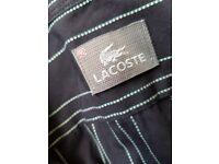 Black Lacoste short sleeved shirt