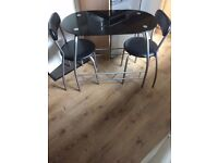 Small black glass table for 2 with seats months old lovely n modern