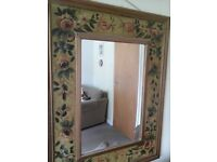 Large ornate wall mirror.
