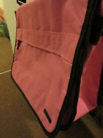 Pink bag trimmed in black. Ideal work uni or college bag.