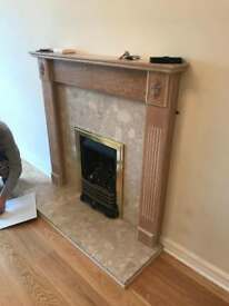 Gas fire with marble surrounding
