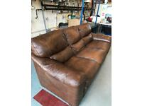 Brown/ dark tan leather three seater sofa