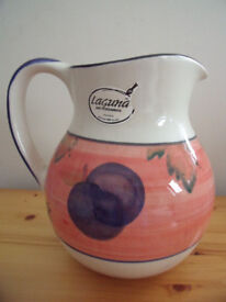 Large Laguna Art Ceramics jug decorated with fruits and vine leaves in terracotta and blue. £4 ovno