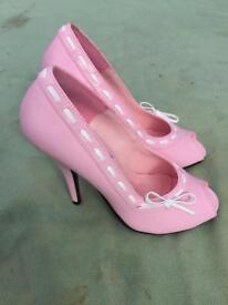 Pink ladies high heels size 4. Brand new never worn!!