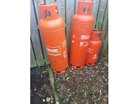 2 large and 1 small propane gas bottle empty