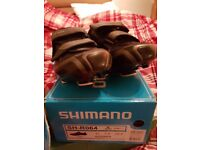 Cycling shoes with cleats. SHIMANO SH-R064, worn a couple of times