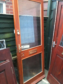 Exterior wooden door with 2 patterned double glazed panels