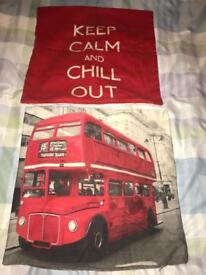 2 cushion covers. London. Red cream