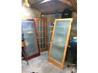 5 hard wood glass panelled doors