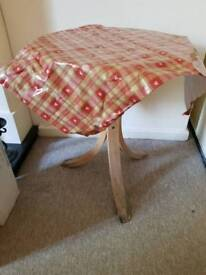 Small wooden table with wipe clean cloth