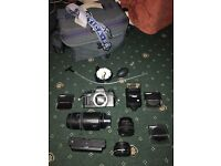 Praktica film camera with lots of accessories