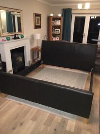 """Super king size dark brown real leather bed. Birch sprung slats. 6'6"""" x 6'. Good condition"""
