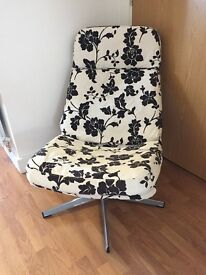 Black and cream Ikea swivel chair