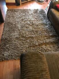 Very large brown shaggy rug