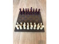 Hand-carved, wooden chessboard with original pieces