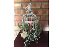 Bird cages with rose flower and other decorations