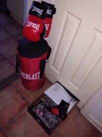 Everlast boxing bag and gloves. Adidas boxing boots