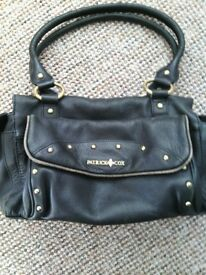 Black leather Patrick Cox medium sized handbag