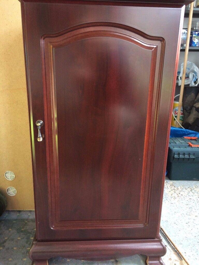 Small, mahogany coloured CD/DVD cabinet